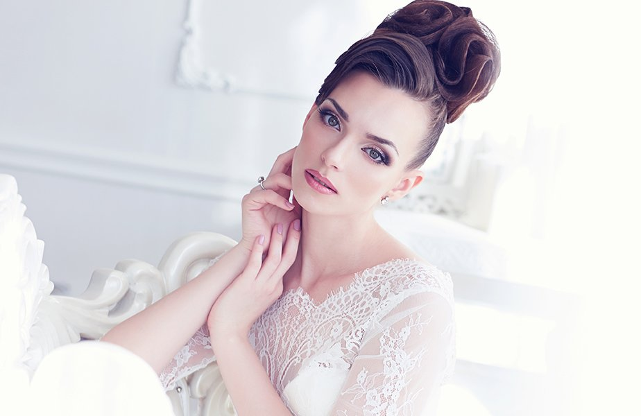 Closeup portrait of young gorgeous bride sitting in antique interior